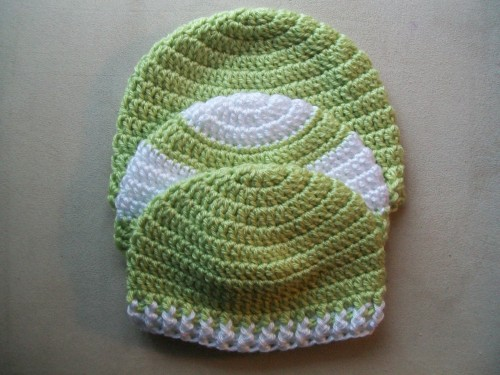 a crochet baby hat collection made in green and white