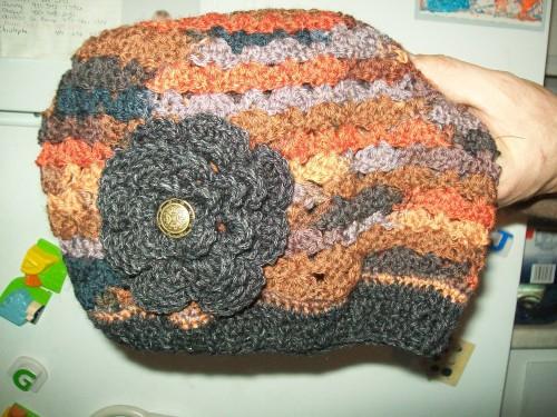 crochet hat with flower in multicolor wool yarn