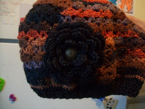 crochet lace hat with flower detail made with wool sock yarn