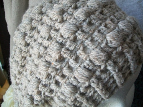 a crochet puff stitch slouch beanie hat made with patons natural blend wool