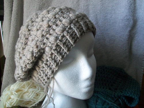 a crochet buff stitch slouch beanie worn to the side