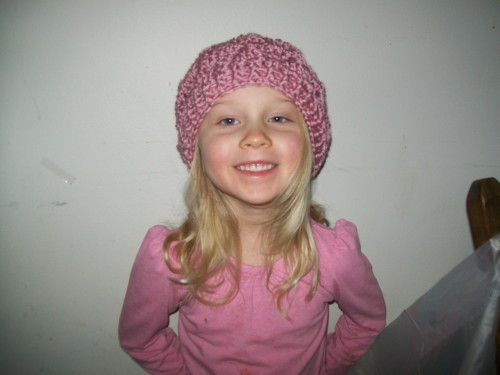 girl with pink crochet tezzie hat