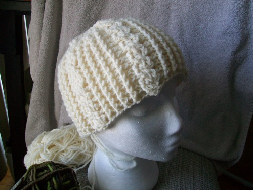 a warm winter crochet hat with ribbing made with patons classic wool