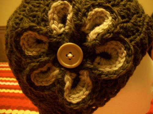 flower on crochet shell beanie hat close up