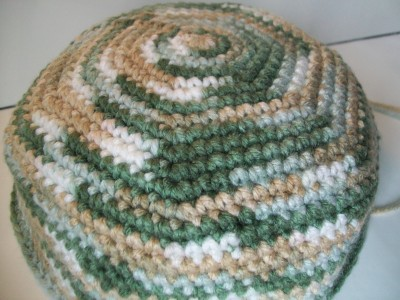 single crochet beanie work in progress made with self changing yarn